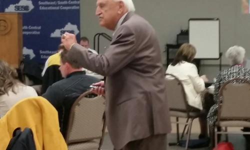 Dr. Robert Barr speaks on poverty issues at a regional workshop.