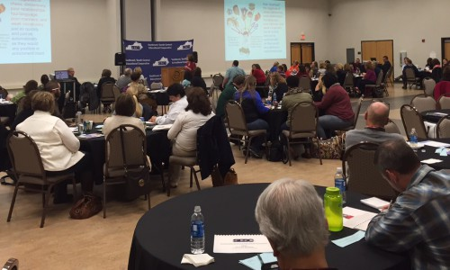 Dr. Kathleen Cooter speaks to a full house at the SESC Poverty Institute.